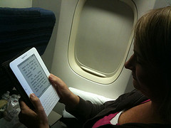 Shelly reading her Kindle on an airplane